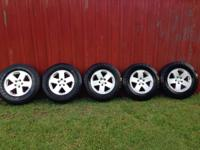 5 Tires and rims from a 2007 Jeep Wrangler. 4 of the