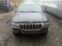 99 jeep grand Cherokee... runs iffy.. beat up.. but its