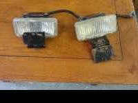 For sale are the two factory fog lights on a Jeep Grand