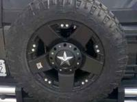 STILL NEW IN THE BOX - 4 Jeep JK Wheels. Fit Jeep 2007