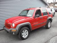 nice jeep awesome color red...great condition inside