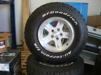 FOR SALE IS A SET OF 5 JEEP FACTORY WHEELS WITH 4 BF