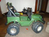 I have a green jeep power wheel. It seats two kids at