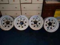 i have some white spoke steel rims that fit jeeps maybe