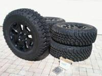 Jeep tires and rims  Miles : < 100 . Removed same