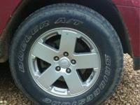 I have a set of 5 matching jeep wheels with Bridgestone