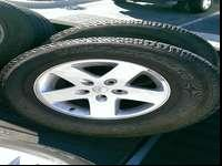Set of 5 wheel and tire. Tires at 1/2 tread and an