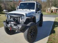 2015 Jeep Wrangler Unlimited 4x4. Built. 4dr. AT w/