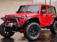 This 2014 Jeep Wrangler Rubicon Unlimited in Flame Red