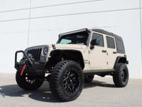This is a Jeep Wrangler for sale by CNC Motors. The