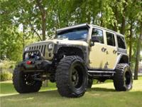 JEEP WRANGLER UNLIMITED SPORT WITH 4? LIFT AND 38?