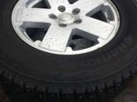 wheels with studded tires 225/70/18 90% tread.