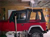 Wrangler yj black soft top used has 6 inch tear in