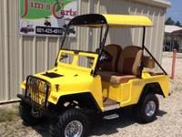 We have a beautiful yellow Jeep customized golf cart