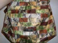 Has a patchwork, snakeskin design on it. Comes with