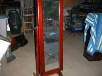 Jewelry armoire tilts with mirror. Cherry wood color,