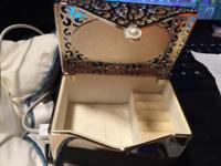 A personalized, engraved keepsake box with delicate