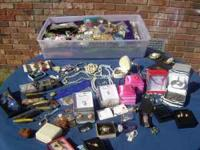 Table and tote full of brand new never worn jewelry
