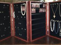 I have 2 cherry finished jewelry showcases with black