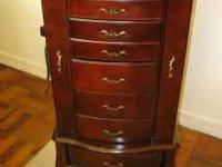 Very nice Jewlery armoire. 7 Drawers, Top opens for