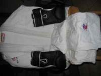 White Jiu-jitsu ghi with pants and belt. size 4A. Used