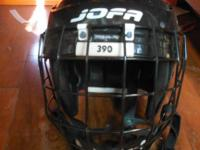 This is a Jofa hockey helmet. The size is 6 3/4- 7 3/8.