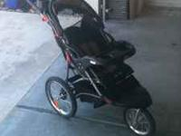 Dependable jogger stroller with cup holders, canopy,