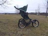 Jogger stroller for sale. $40 or best offer. Call Gina