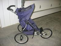 Single Jogging Stroller with Weather Cover. Has Front