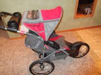 Baby Trend Expedition jogging stroller. Red in color