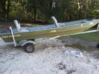 For sale: A John Boat with trailor 15hp Johnson