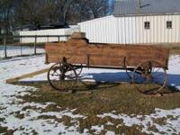 This is a John Deere wagon with a new pine box and
