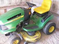 4 year old John Deer LA110 riding mower. Runs great.