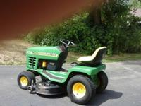 Riding lawn mower and mulcher. Like new condition; new