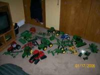Up for sale is an assortments of toy tractors, mainly