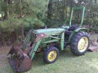 For sale John Deere 1050 4x4, has bucket on front and