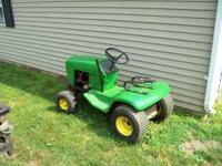 John Deere 111 lawn tractor without the mower deck.