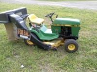 John Deere riding lawn mower. Comes with a lawn