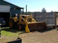 John Deere 210 c Loader tractor $8,500 runs good