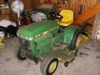 John Deere garden tractor; includes mower deck, plow