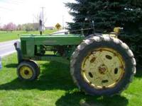 1953 John Deere 50 runs great, good tires. Asking