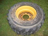 Here is a John Deere 12X16.5 skid steer tire and rim