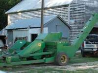 john deere 300 corn picker, been used on about 20 acres
