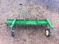 This is a used thatcher attachment for a John Deere 318