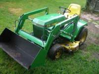 for sale is a john deere 318 garden tractor with a