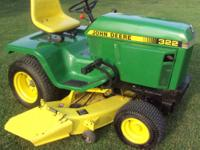 This is a John Deere 322. This is an antique lawn mower