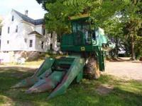 John Deere 3300 harvester. Comes with 2 row corn head