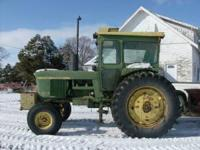 1970 John Deere 4020 with factory cab, Wide Front, side