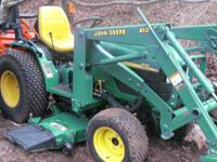 CREAM PUFF OF A JOHN DEERE MODEL 4100 COMPACT TRACTOR,