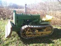 My dad left me his legacy. This old dozer functions